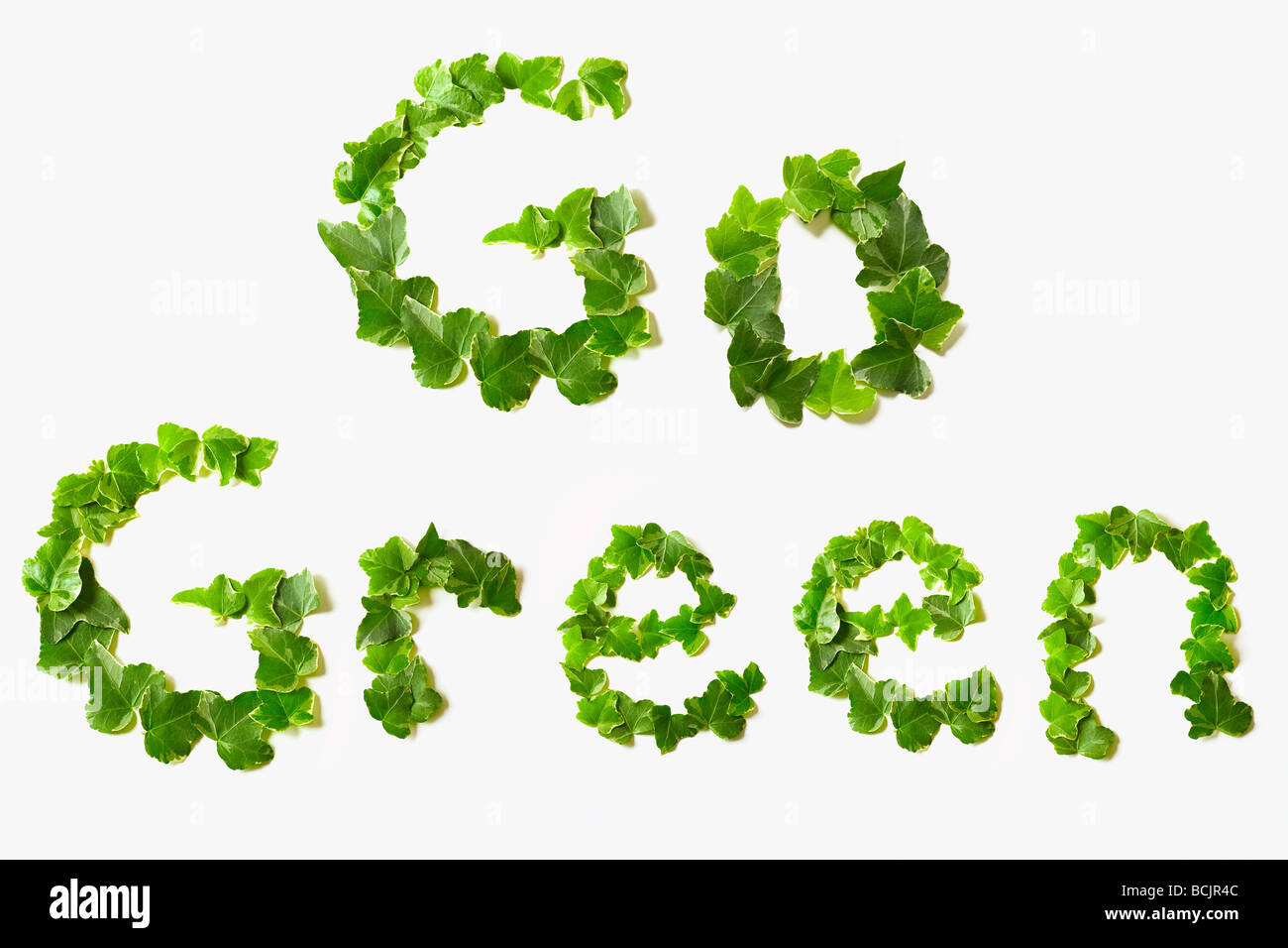 Go green written with leaves - Stock Image