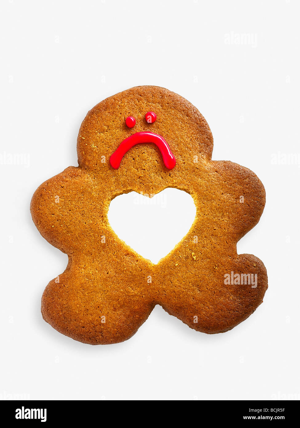 Gingerbread man with missing heart - Stock Image