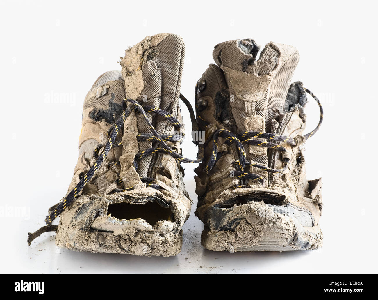 Worn out hiking boots - Stock Image