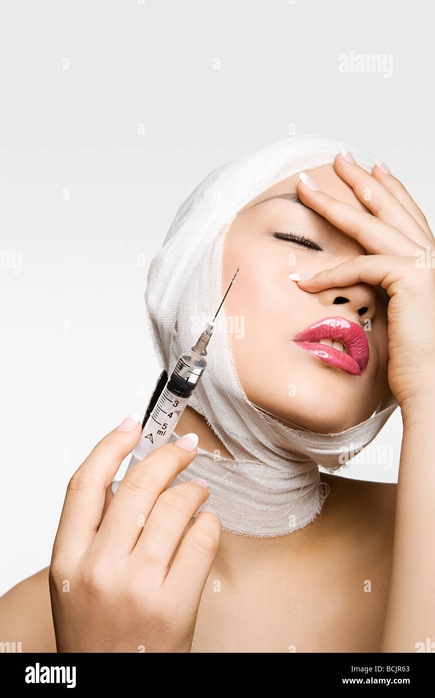 Young woman having cosmetic surgery - Stock Image