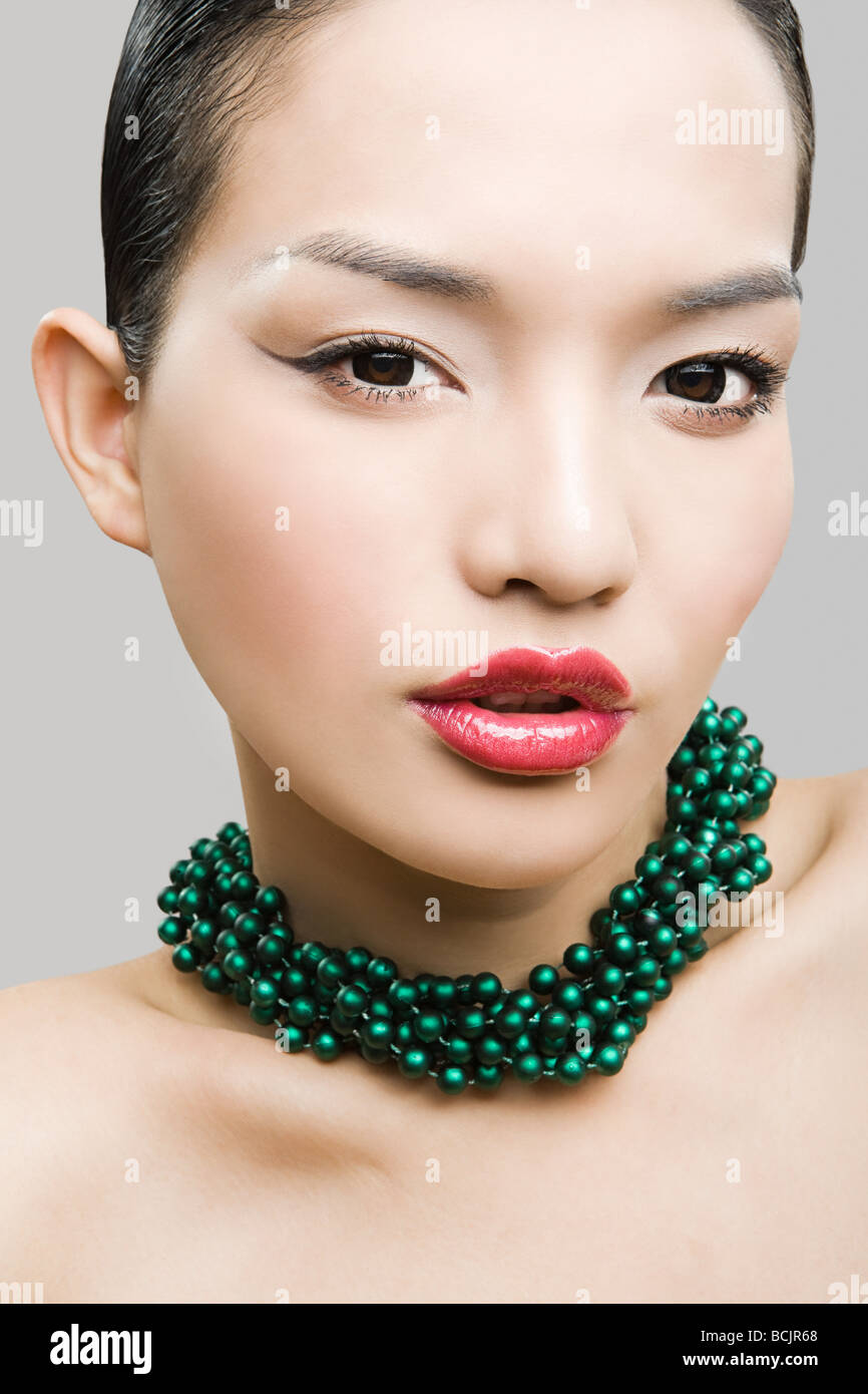 Young woman wearing necklace - Stock Image
