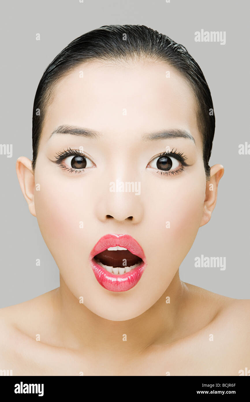 Shocked young woman - Stock Image