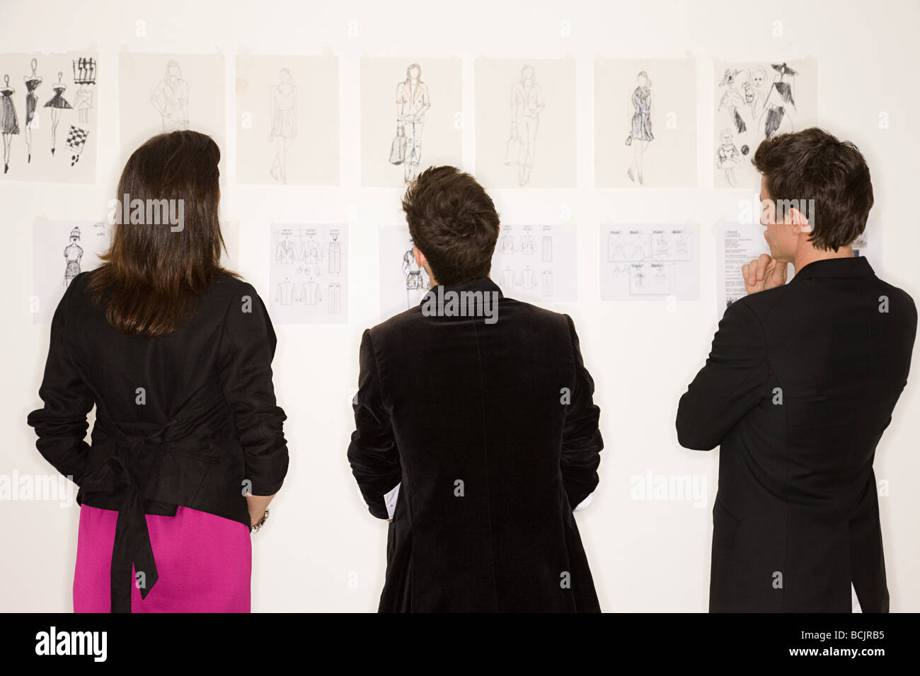Fashion designers looking at designs - Stock Image