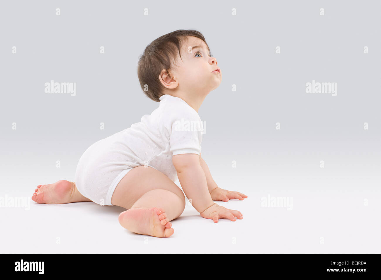 Baby looking up - Stock Image