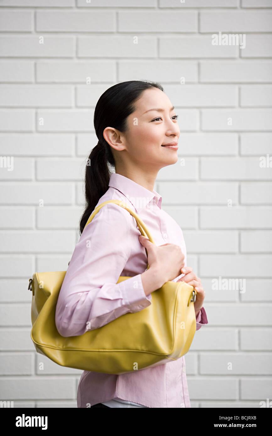 Japanese woman with a handbag - Stock Image