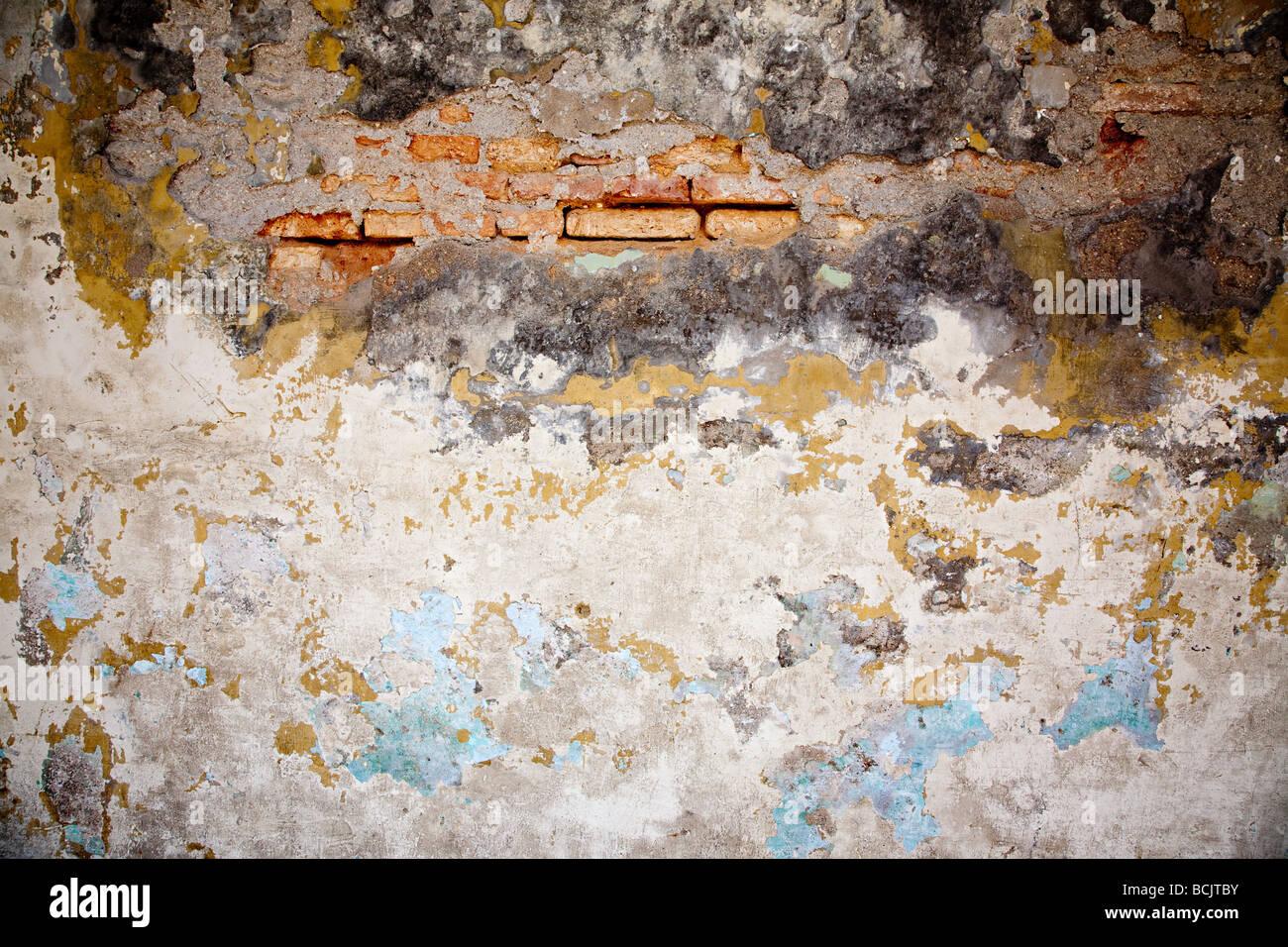 A damaged wall - Stock Image