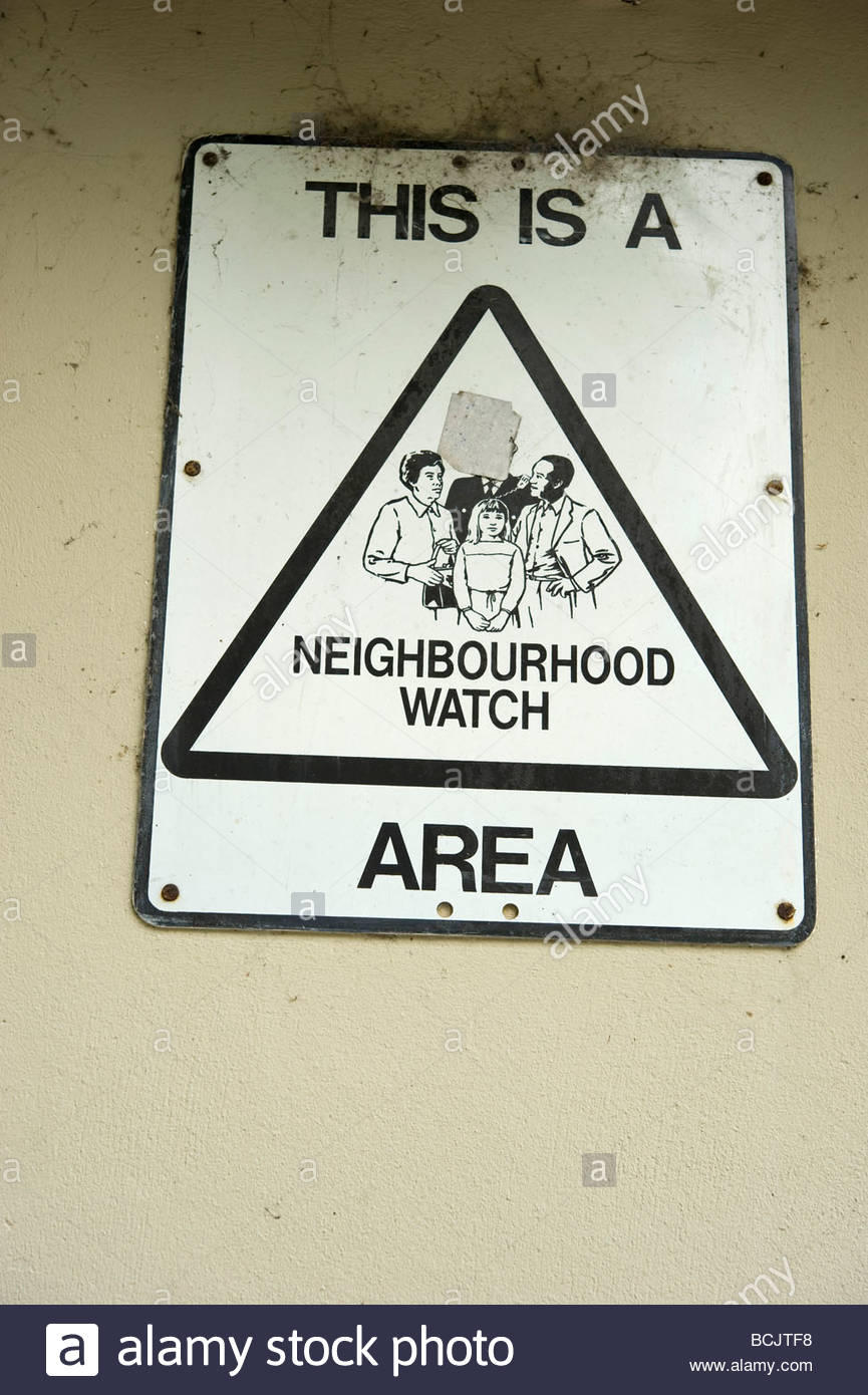 This is a Neighbourhood watch area sign on a wall - Stock Image