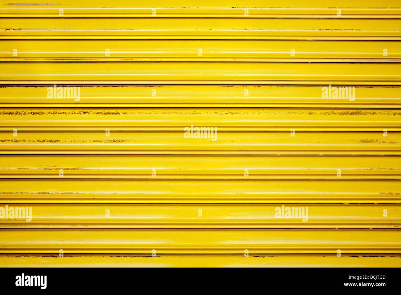 Closed yellow shutter - Stock Image