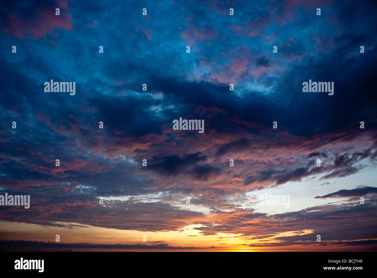 Cloudy sky at sunset - Stock Image