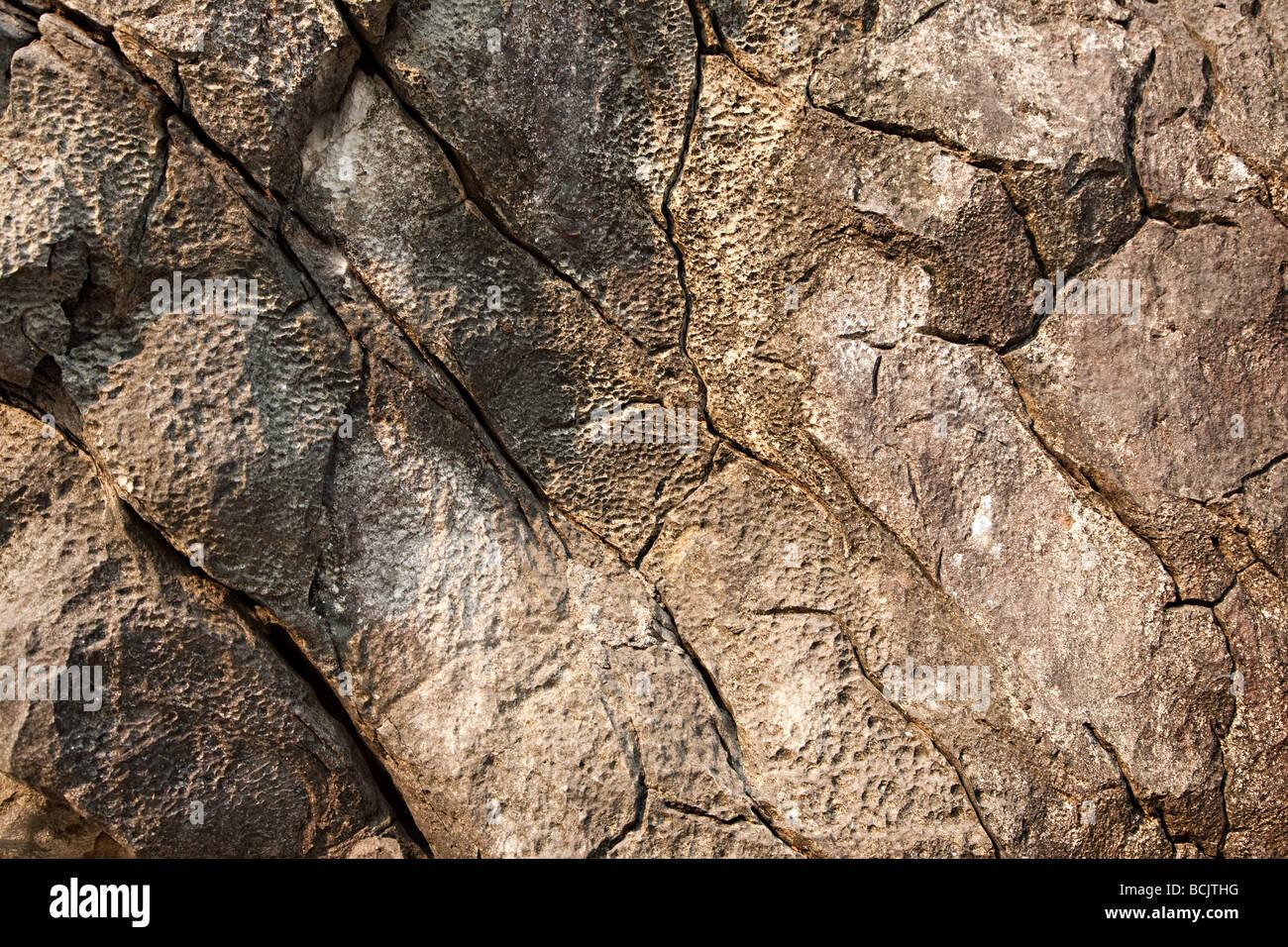 Close up image of cracked rocks - Stock Image