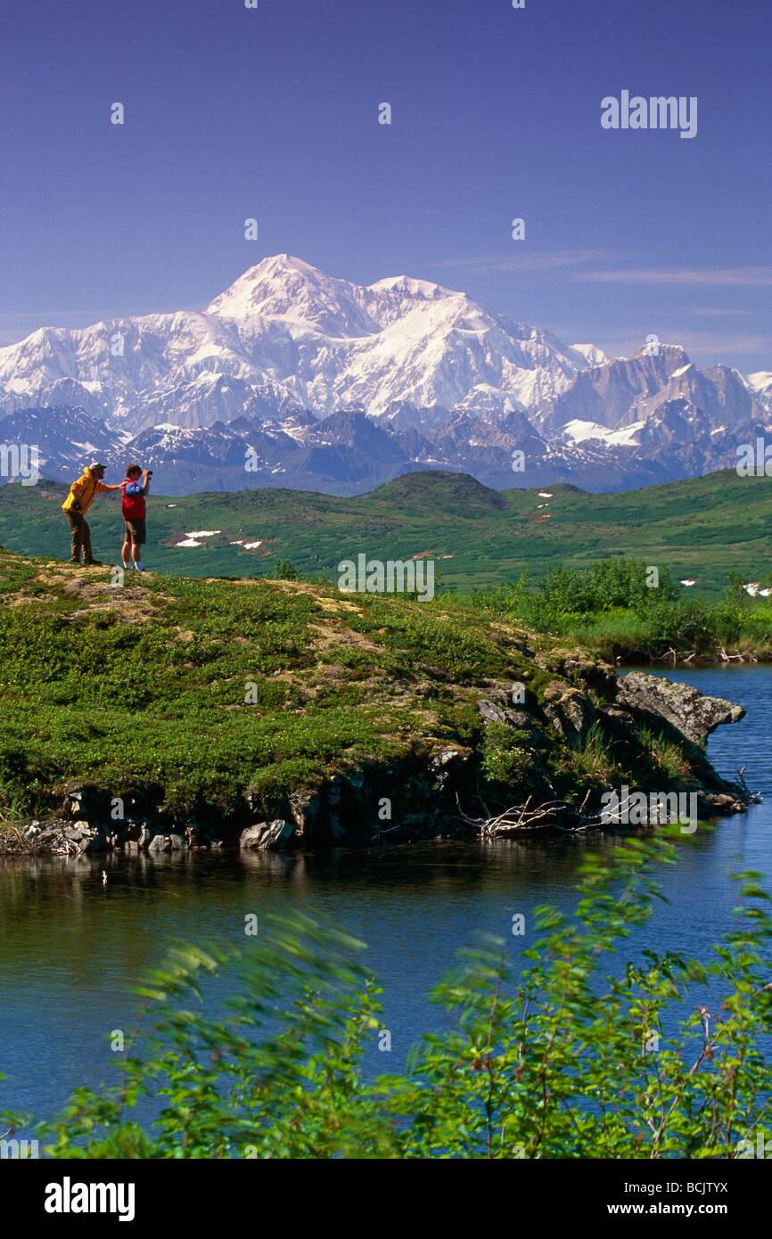 Hikers on Kesugi Ridge Denali SP AK w/Mt McKinley background SC Summer Stock Photo