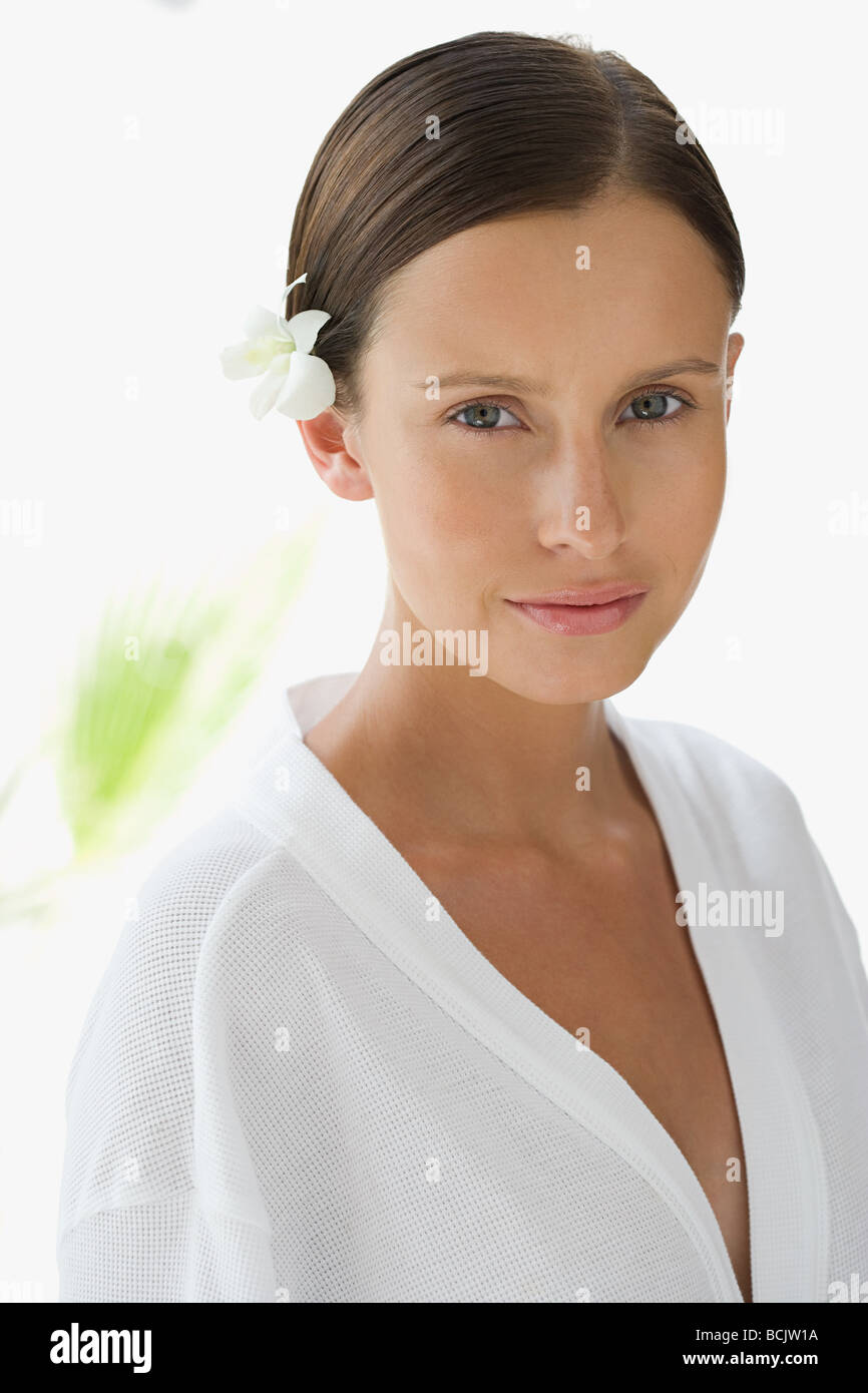 Portrait of young woman with flower in hair at health spa Stock Photo