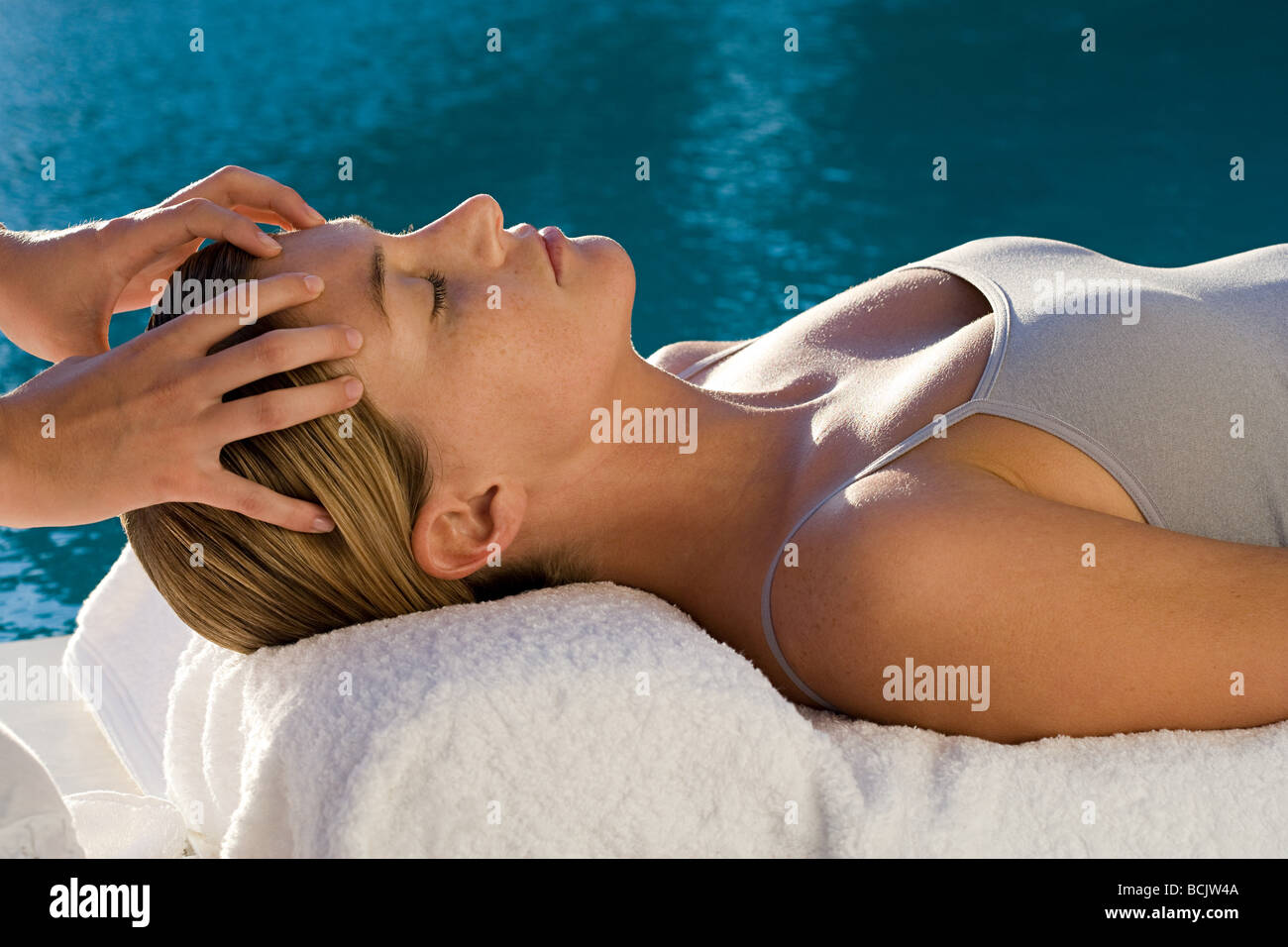Young woman receiving facial massage - Stock Image