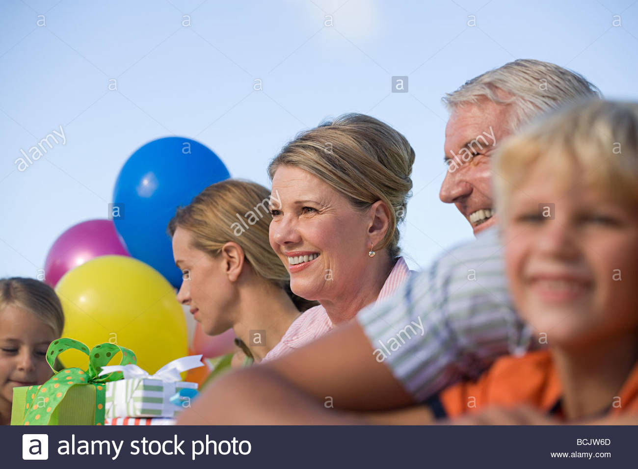Family members at a child's birthday party - Stock Image