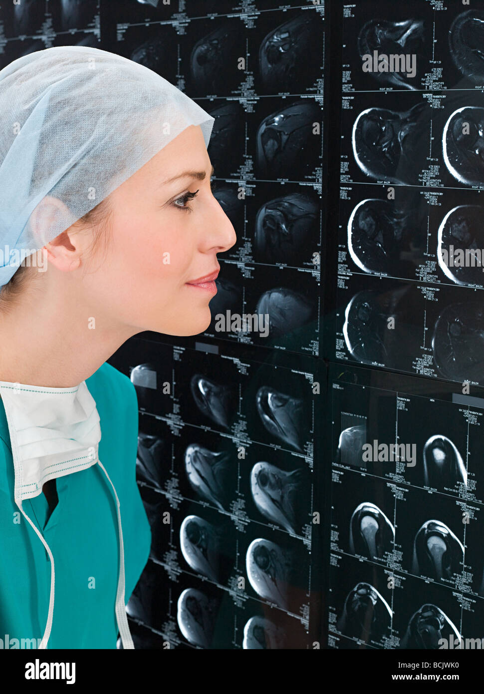 Female doctors looking at x-rays - Stock Image