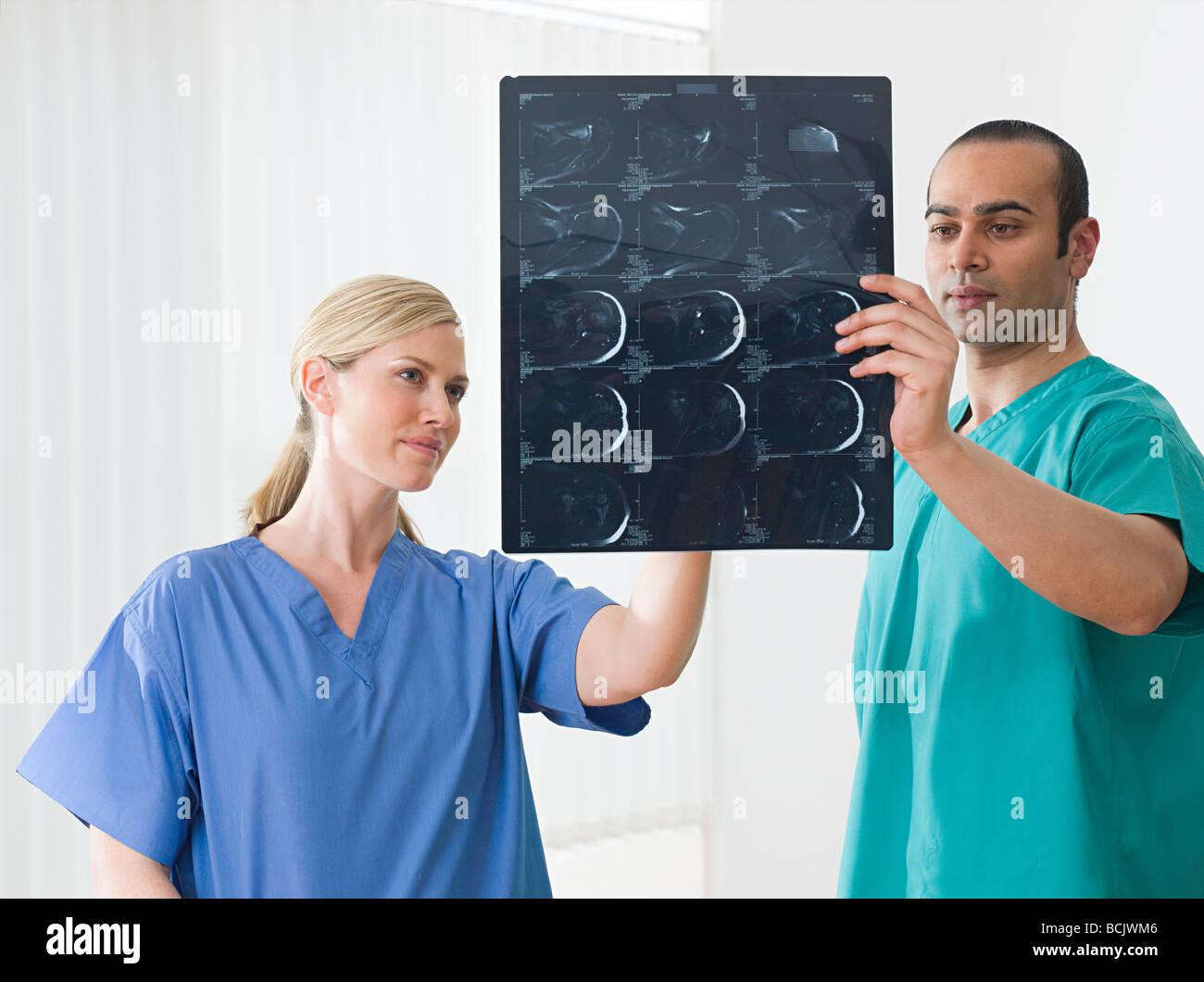 Medical colleagues holding an xray - Stock Image