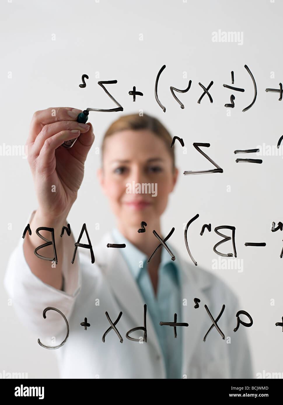Scientist writing a formula - Stock Image