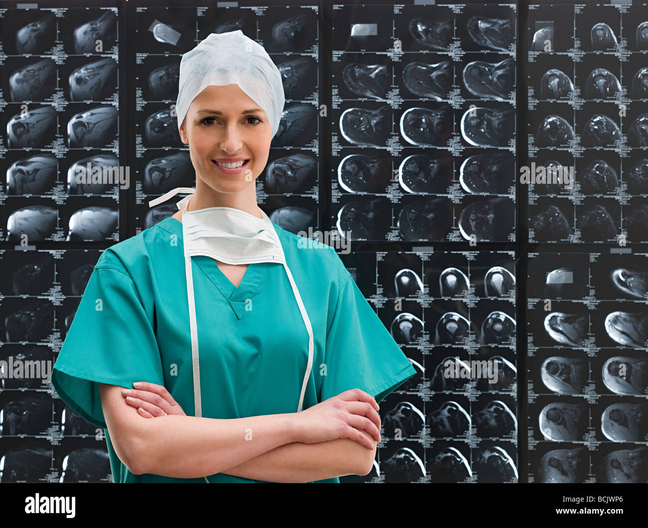 Female surgeon and x-rays - Stock Image
