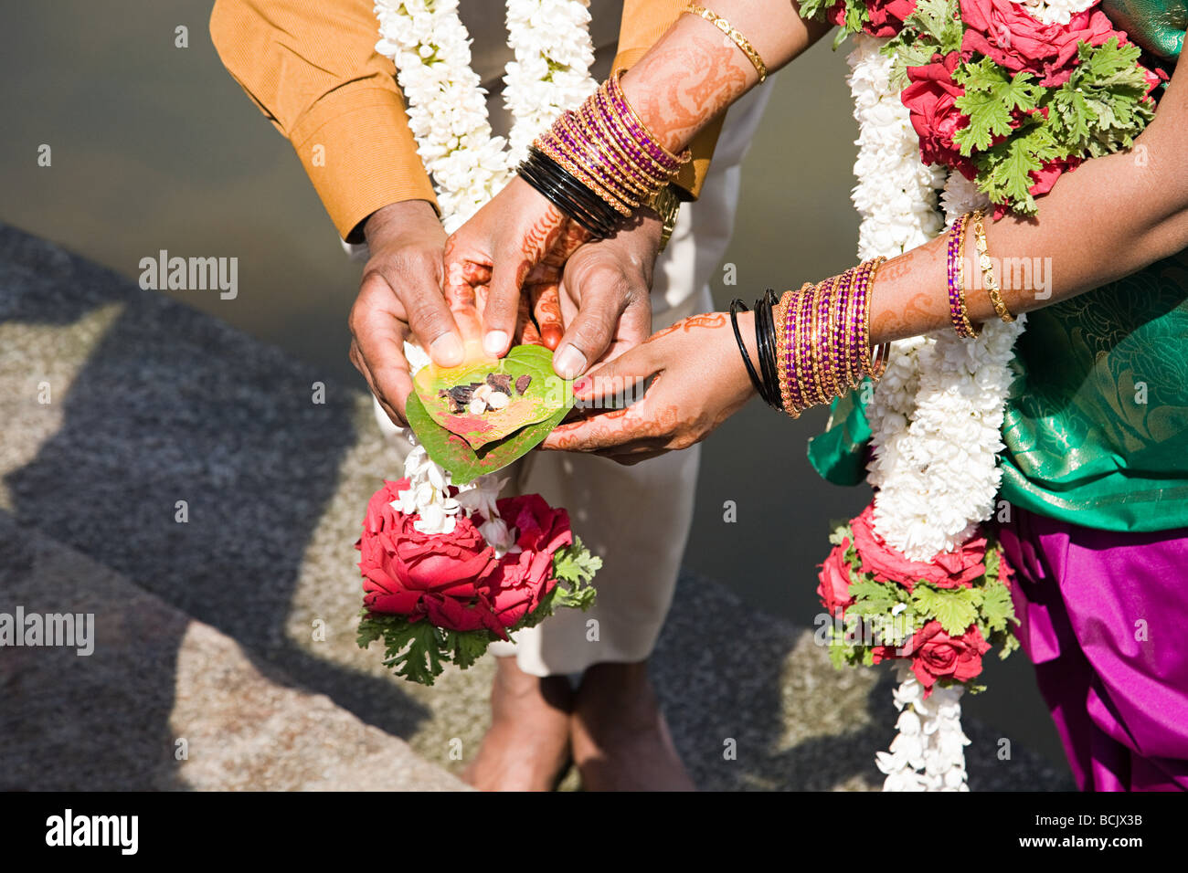 Couple holding puja in indian wedding ceremony Stock Photo