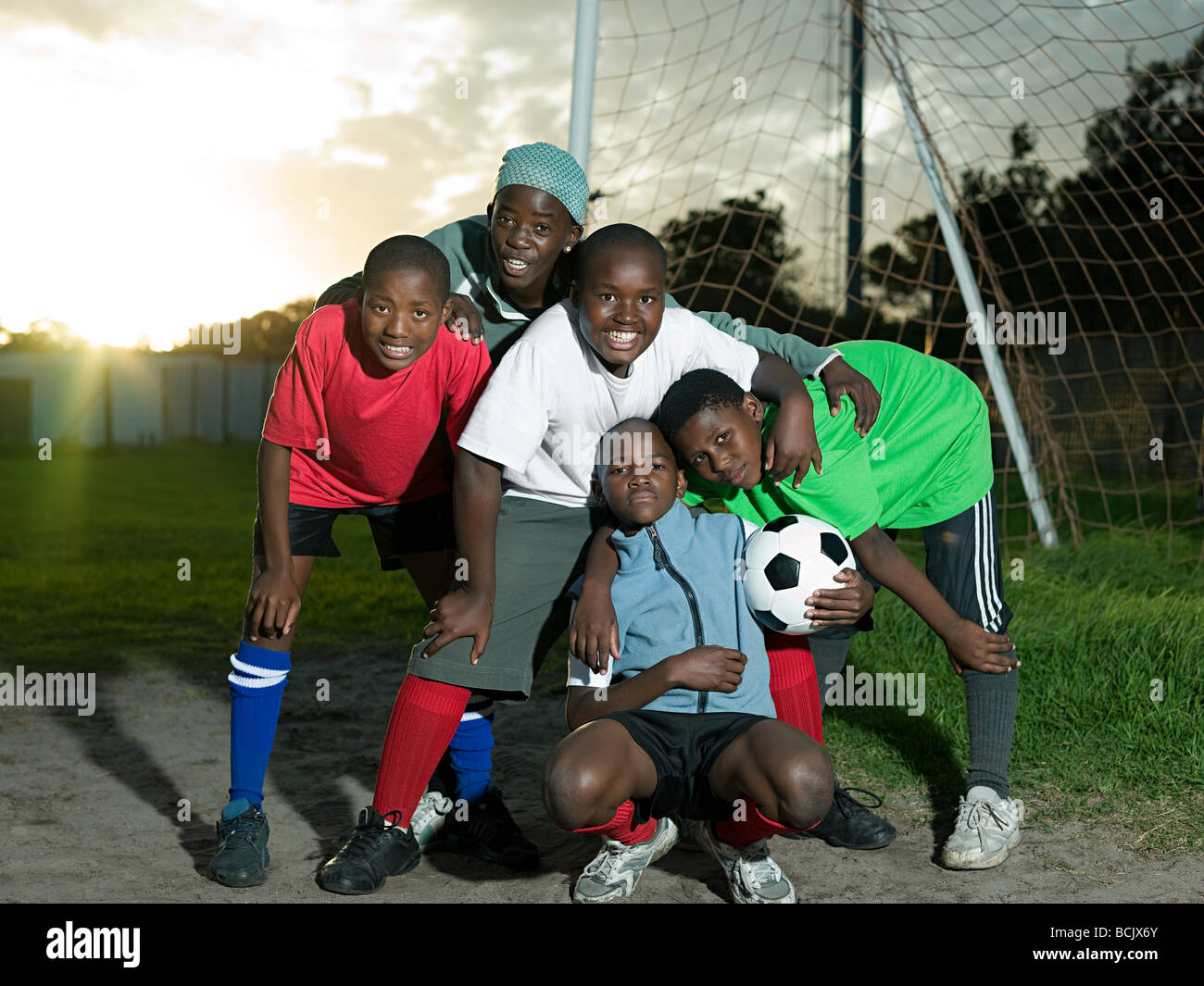 Group of teenage boys with football - Stock Image