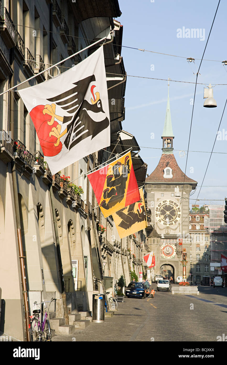 Flags hanging on a swiss street - Stock Image