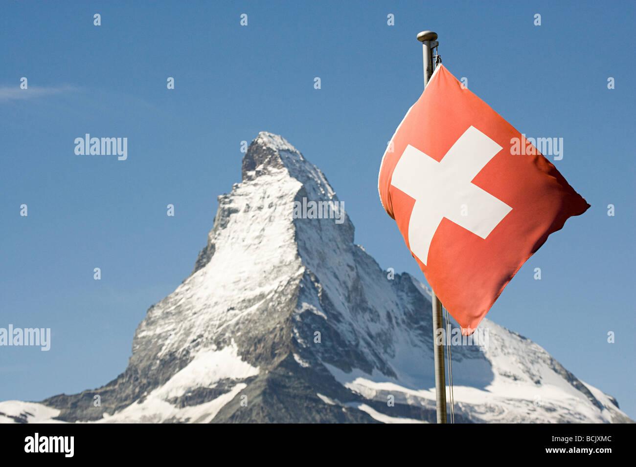 Swiss flag and matterhorn - Stock Image