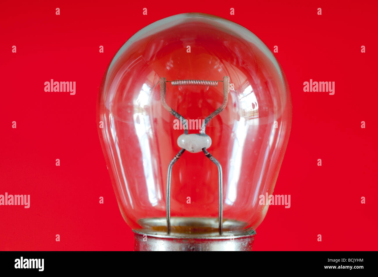 Electric coil filament in a small 12volt bulb - Stock Image
