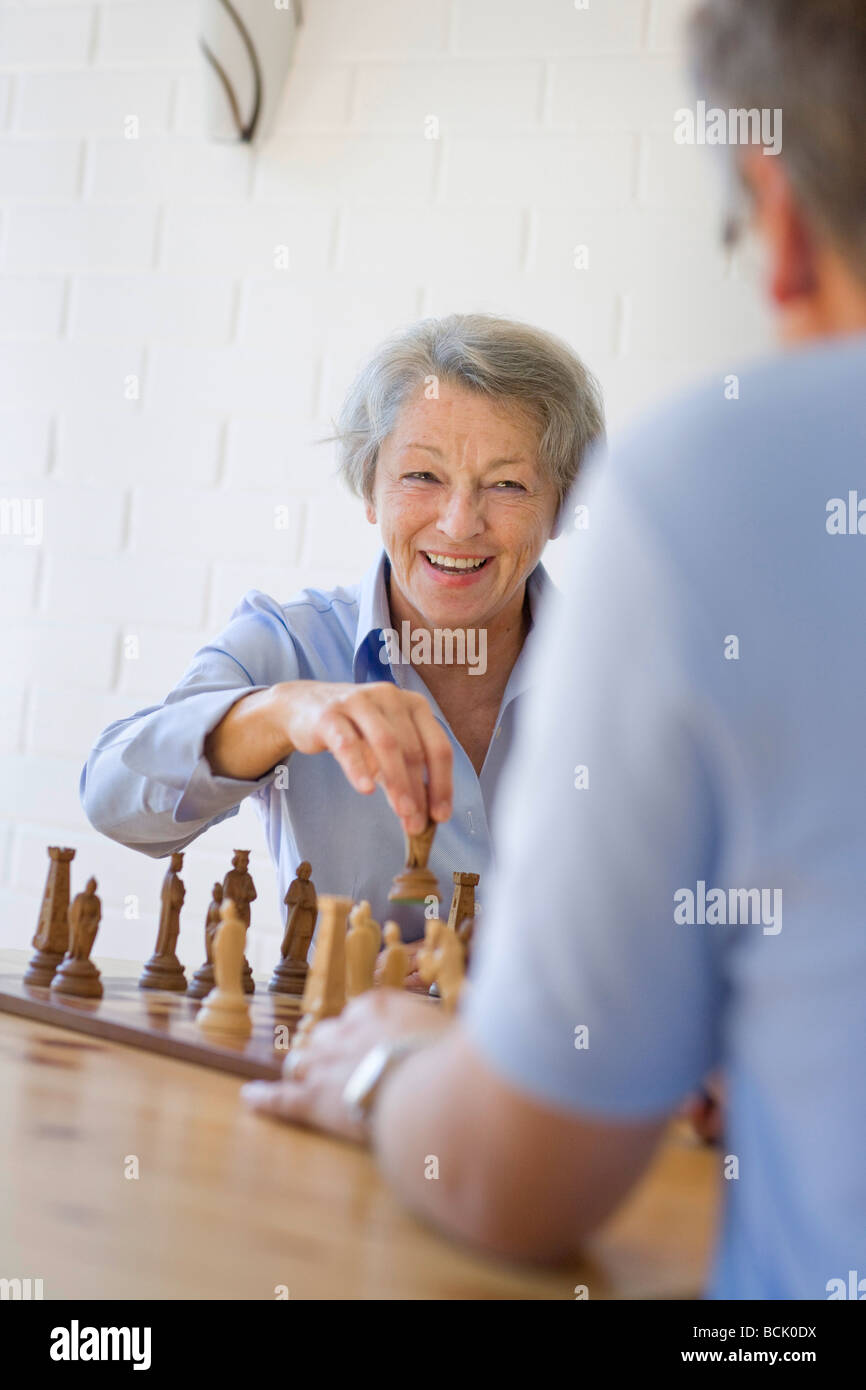 Elderly person gaming chess - Stock Image