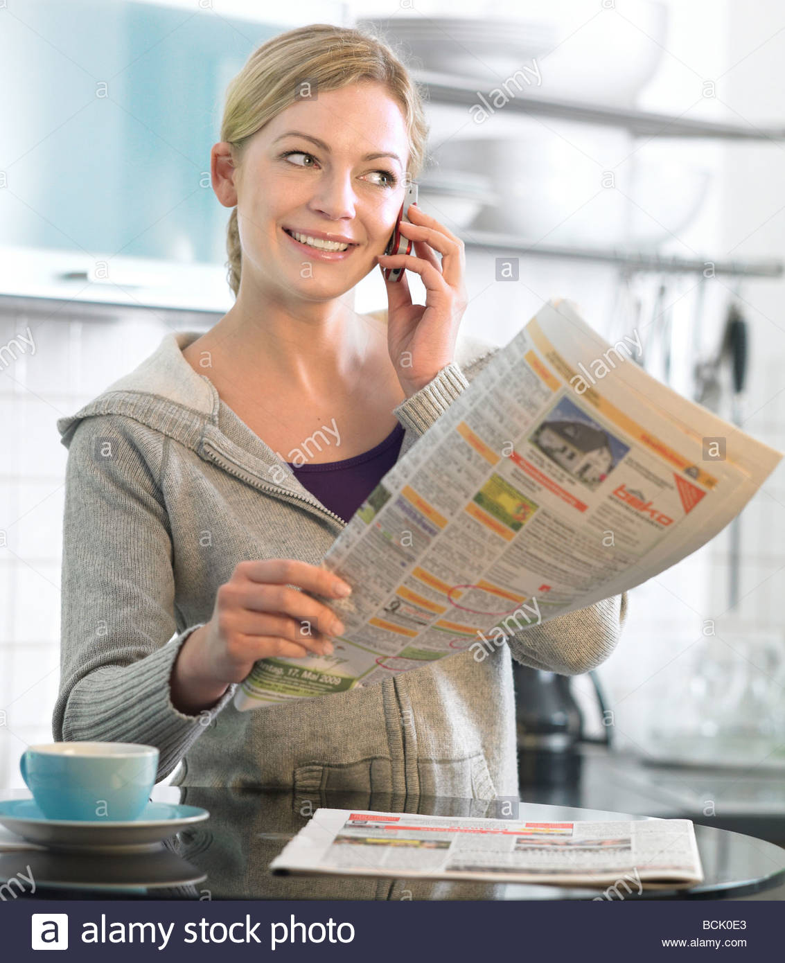 brunette woman searching a job in newspaper Stock Photo