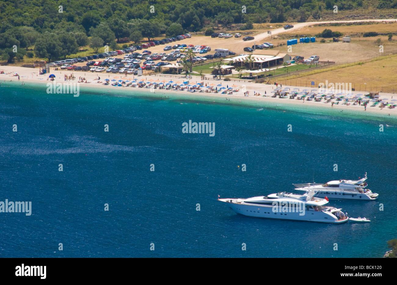 View over Antisamos beach with luxury cruisers moored near Sami on the Greek island of Kefalonia Greece GR - Stock Image