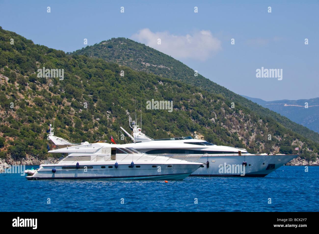 Luxury cruisers moored off Antisamos beach near Sami on the Greek island of Kefalonia Greece GR - Stock Image