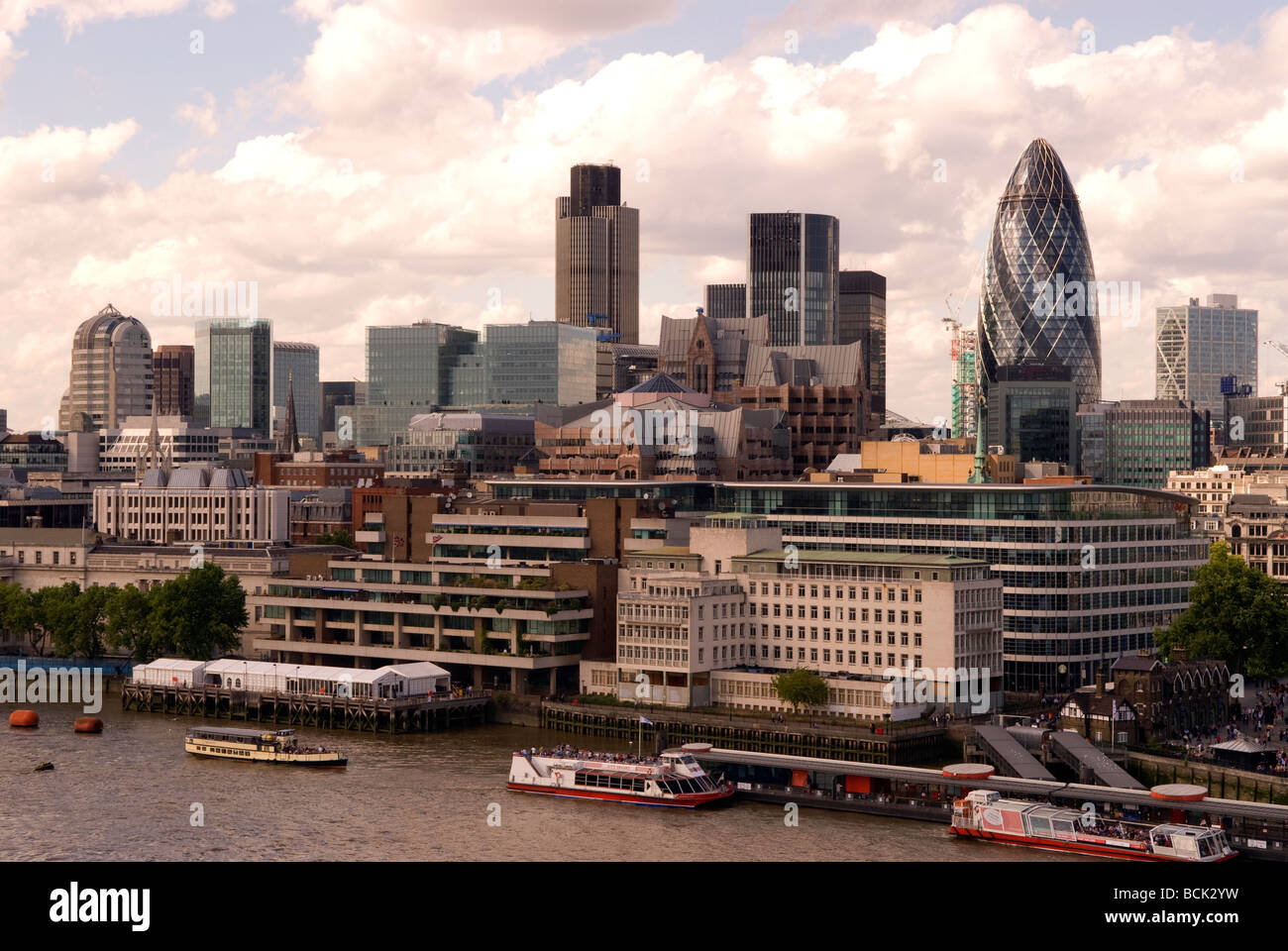 City of London showing a range of business and financial institutions including the famous Gherkin building, London, - Stock Image