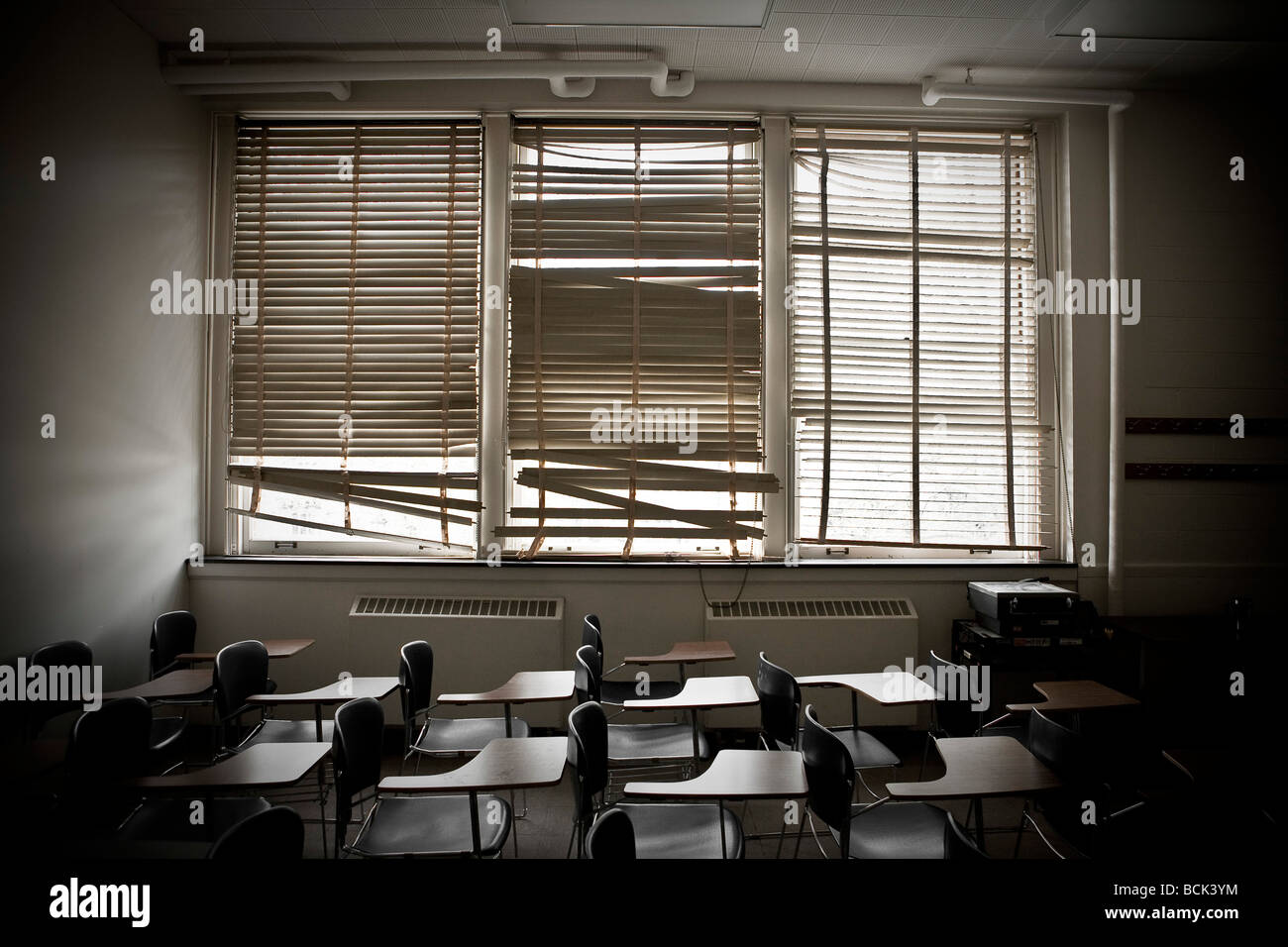 Old classroom with broken window blinds Stock Photo