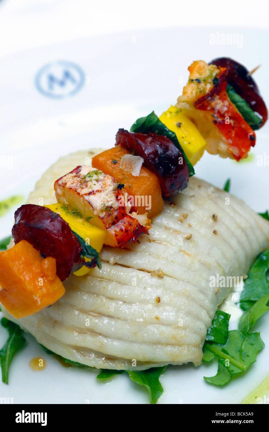 Metro bar and grill Cornwall Street Food is roast skate with lobster mango and chorizo kebab rocket and aioli salad - Stock Image