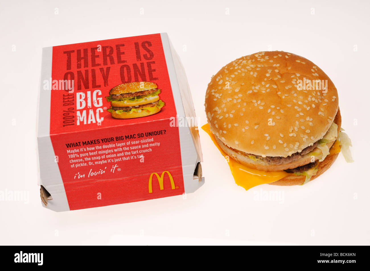 Mcdonalds Big Mac with packaging on white background. - Stock Image