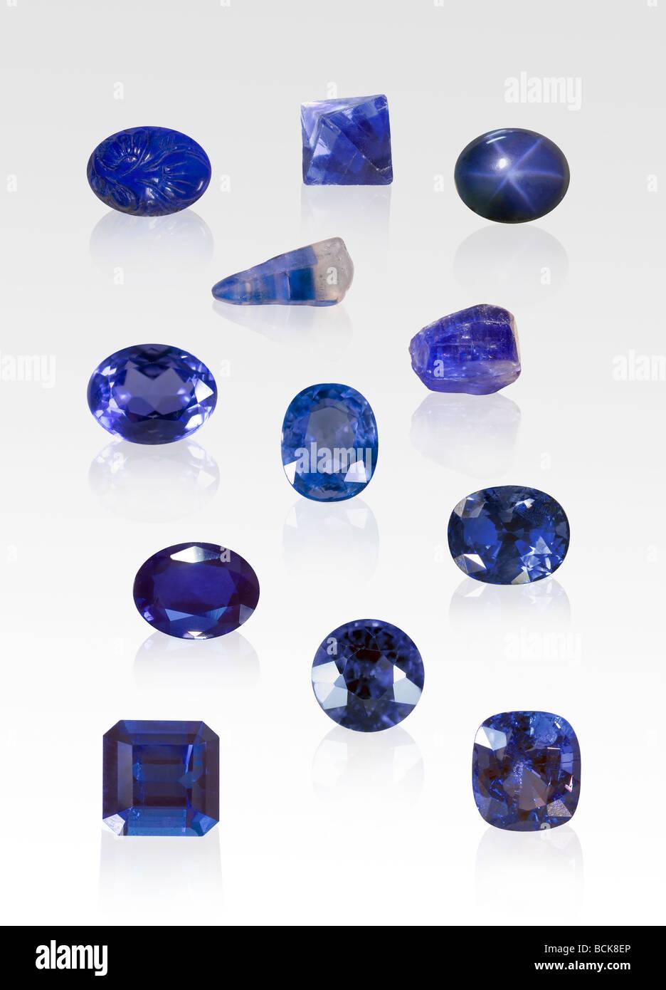 Indigo gemstone and crystal specimens on white background - Stock Image
