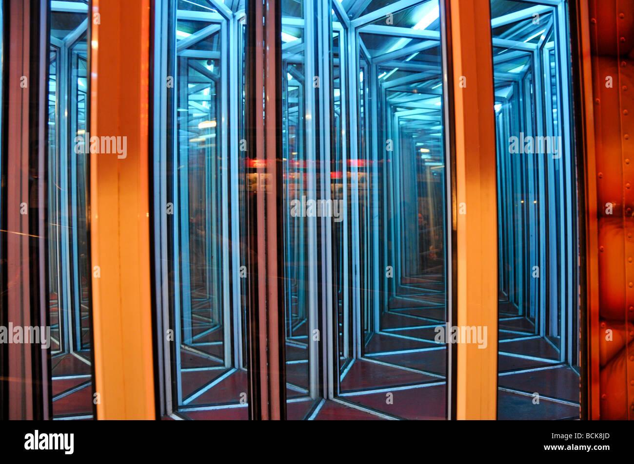 Maze of mirrors in Abingdon Michaelmas Fair England - Stock Image