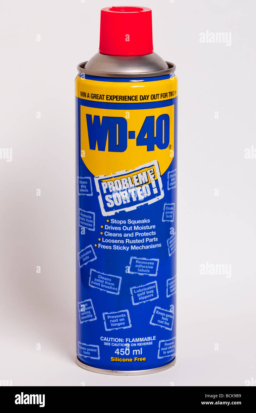 A close up of a can of WD 40 oil lubricant against a white background - Stock Image