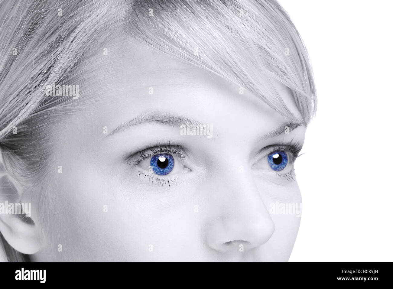 Abstract image of a blond woman with blue eyes - Stock Image