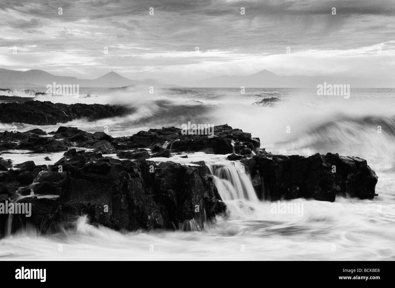 Waves breaking over rocks on north coast of Gran Canaria in The Canary Islands. - Stock Image