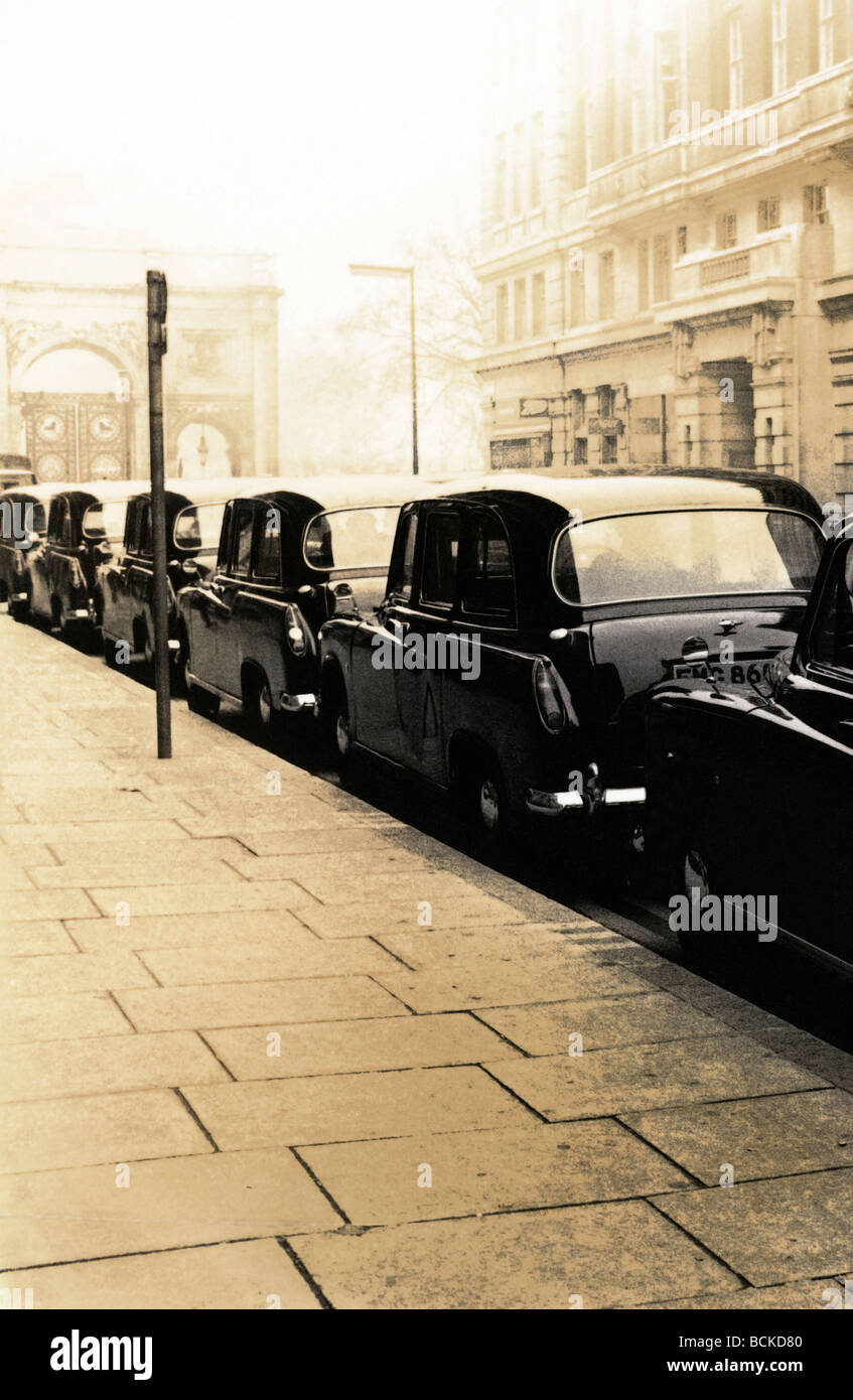 Row of cars parked along road, b&w, toned - Stock Image