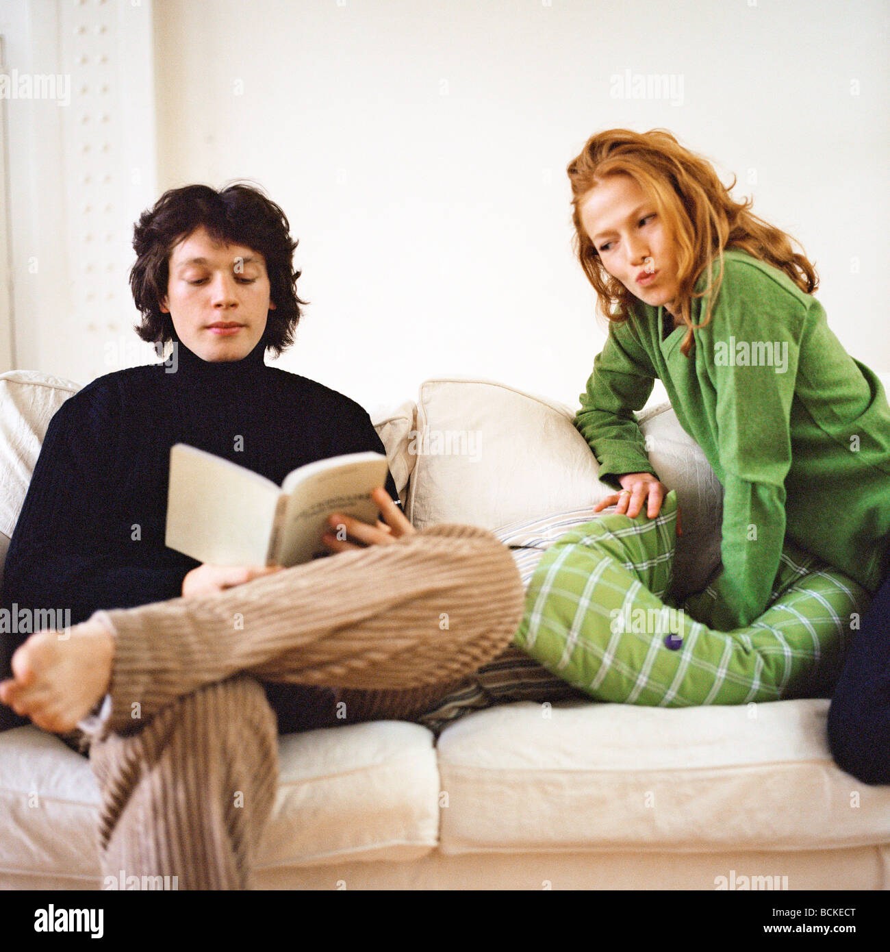 Couple on sofa - Stock Image