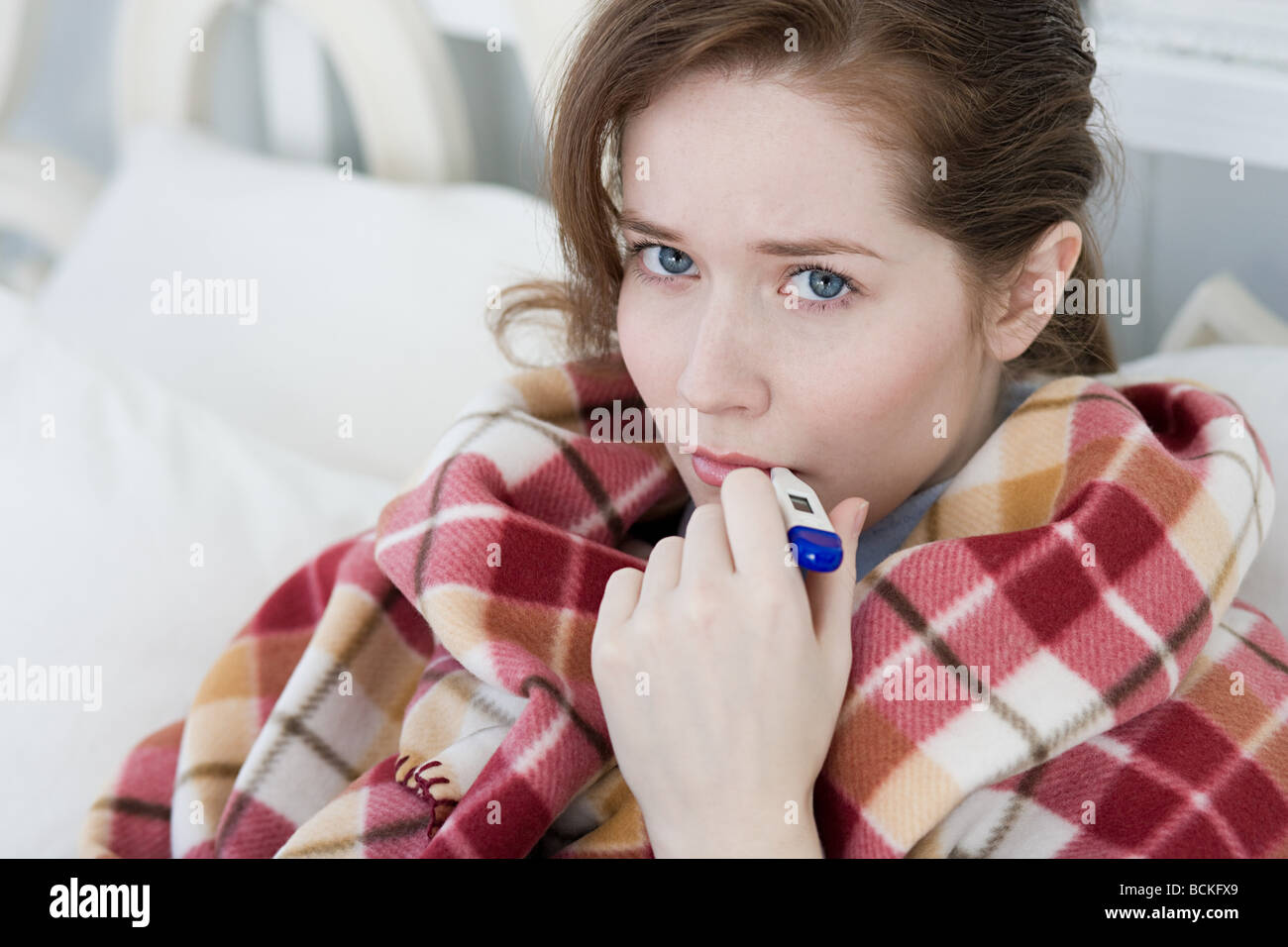 Ill young woman - Stock Image