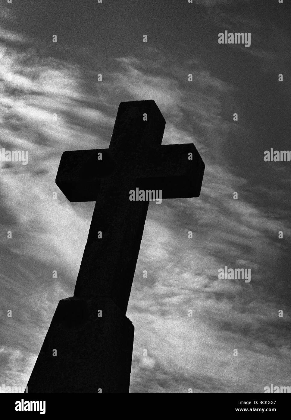 Silhouette of cross in front of sky, b&w - Stock Image