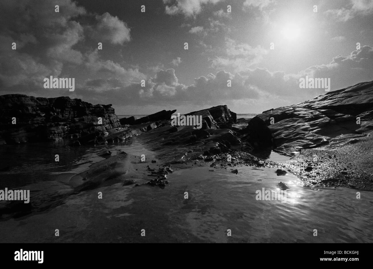 Rocky seaside, b&w - Stock Image