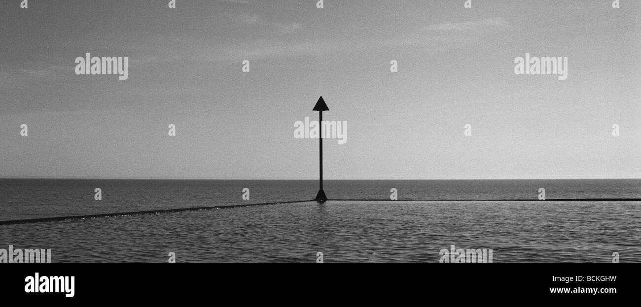 Sign in sea, b&w - Stock Image