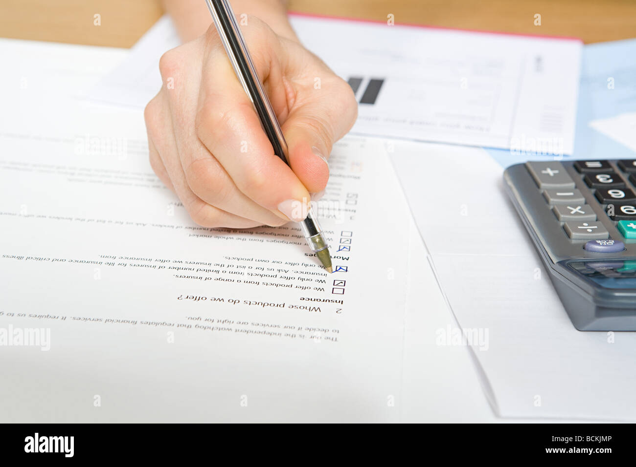 Person filling in form - Stock Image
