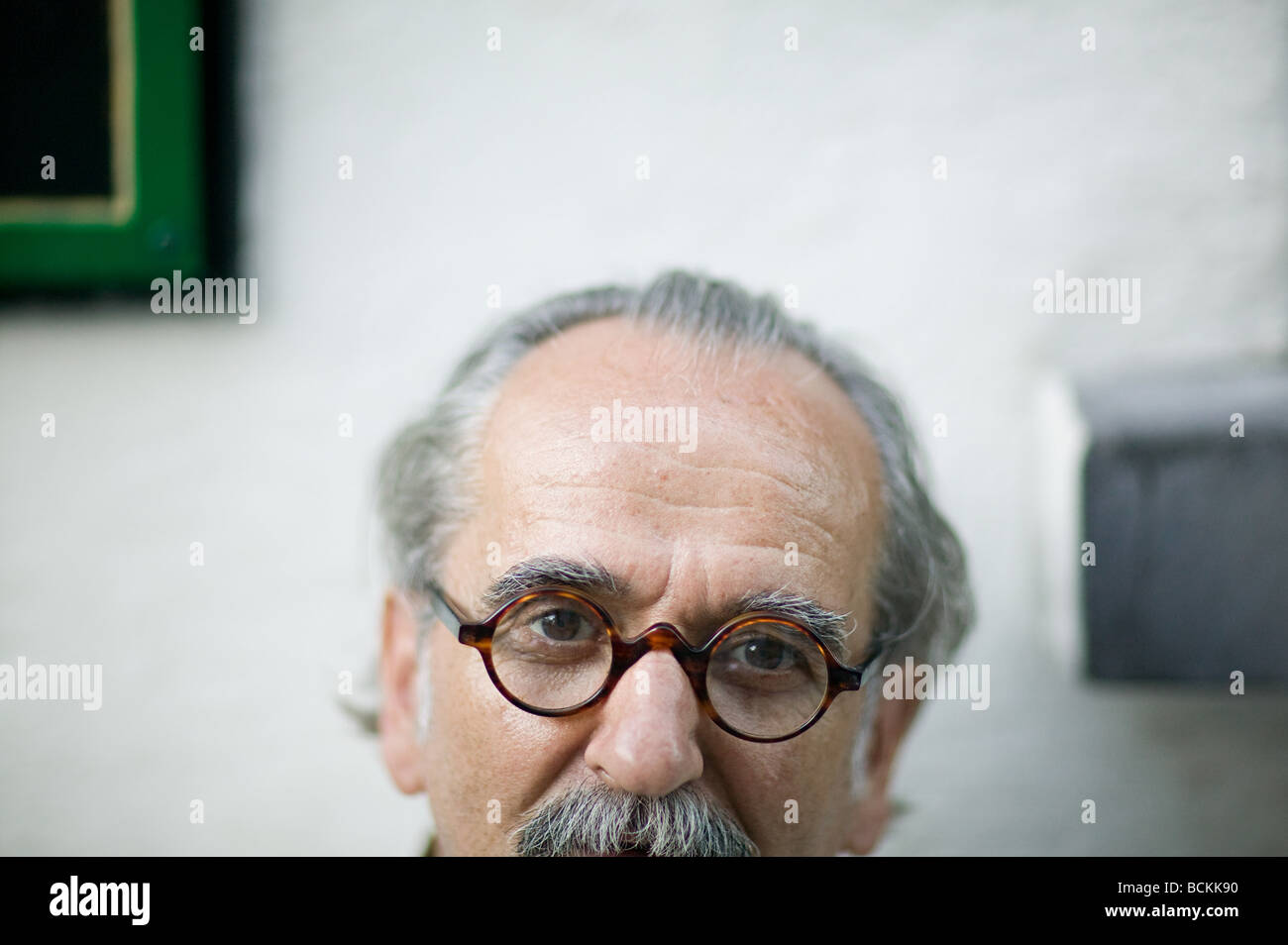 Portrait of a senior man with a mustache - Stock Image