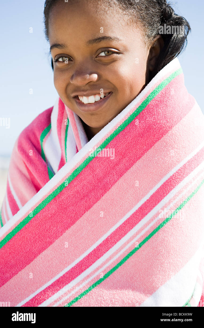 Tween girl wrapped in a towel - Stock Image