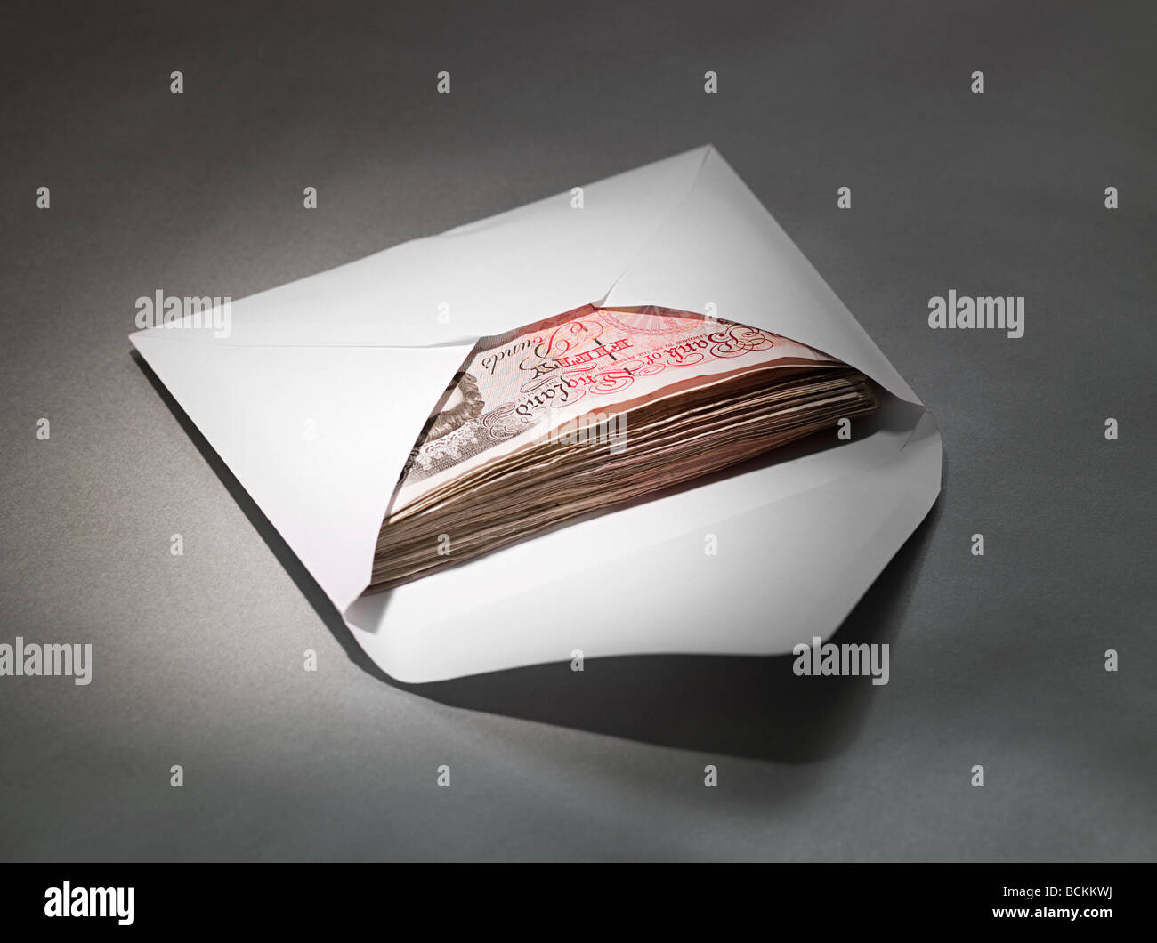 Fifty pound notes in an envelope - Stock Image